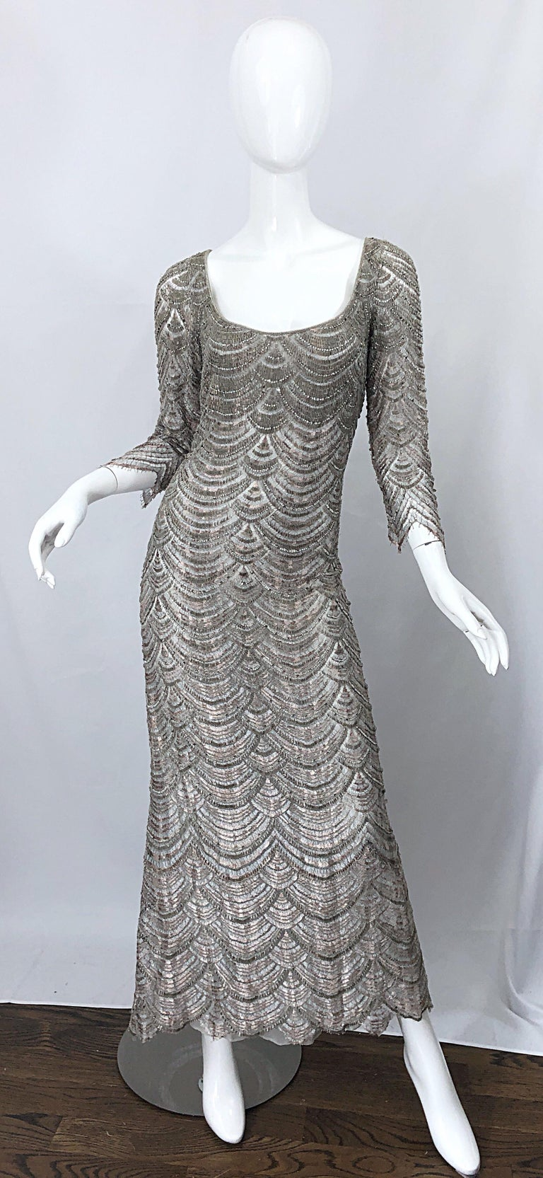 Beautiful vintage 1990s BADGLEY MISCHKA size 12 gray fully beaded + rhinestone deco style evening gown! Features elegant 3/4 sleeves with a fitted bodice and forgiving skirt. Hand crochet embroidery detail thorughout with thousands of  hand-sewn