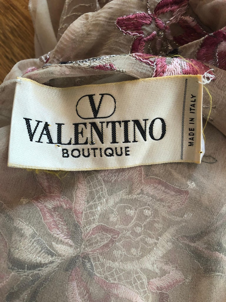 Beautiful 1990s VALENTINO nude silk chiffon semi sheer embroidered dress ! Pictures do not even begin to do this rare gem justice. Hand embroidery in various shades of pink, gray, white and metallic silver throughout. Couture quality with heavy