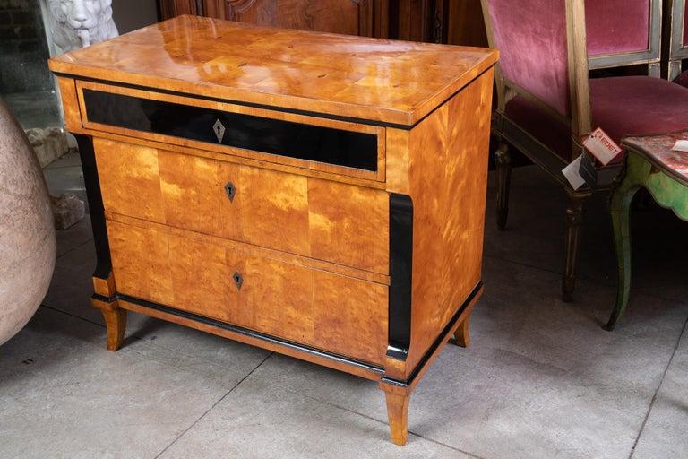 Always chic 19th century Biedermeier maple and ebony commode.