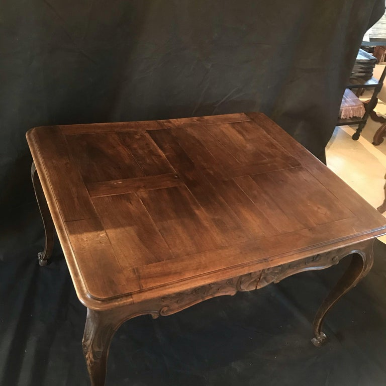 """Beautiful 19th century country French Louis XV carved walnut dining table. Can also be used as a large desk or game table. Gorgeous banded parquet table top. No leaves included. Measures: H skirt 22.5"""" #1903."""