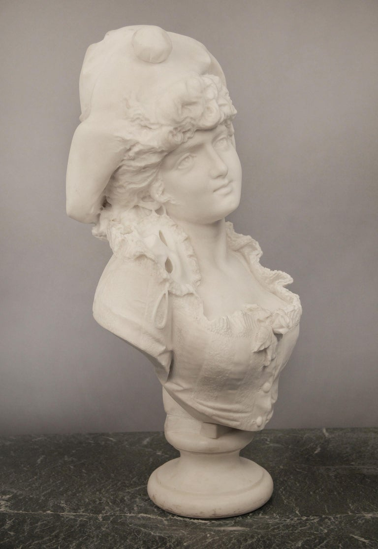 Beautiful Late 19th century Italian white Carrara marble bust of a woman by F. Musaglino  The woman glancing afar with a hat covering her curly hair and a masquerade mask around her ear and sitting on her shoulder, her ruffled blouse centered with