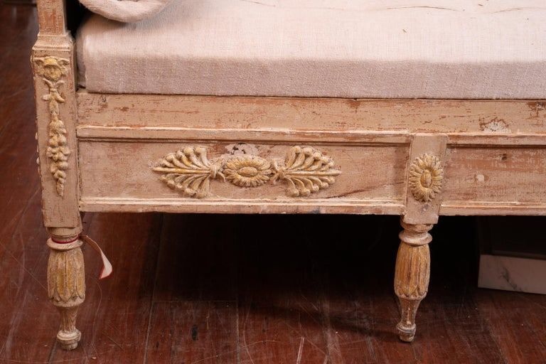 Wonderfully carved Gustavian sofa with original painted surface.