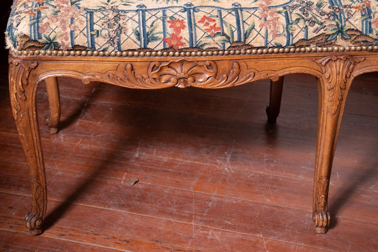 Carved Beautiful 19th Century Walnut Bench with Original Needlepoint Cushion For Sale