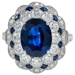 Art Deco inspired 2.19 Carat Platinum Oval Sapphire and Diamond Ring