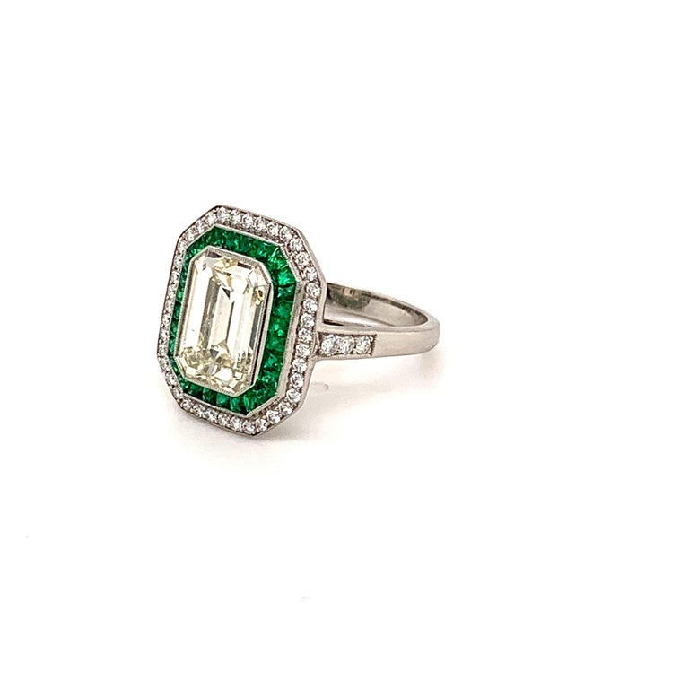 Women's Stunning 2.84 Carat Emerald Cut Diamond Ring and Emerald Ring For Sale