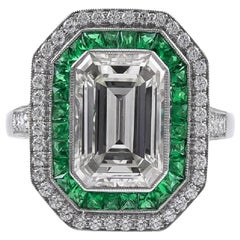 Stunning 2.84 Carat Emerald Cut Diamond Ring and Emerald Ring