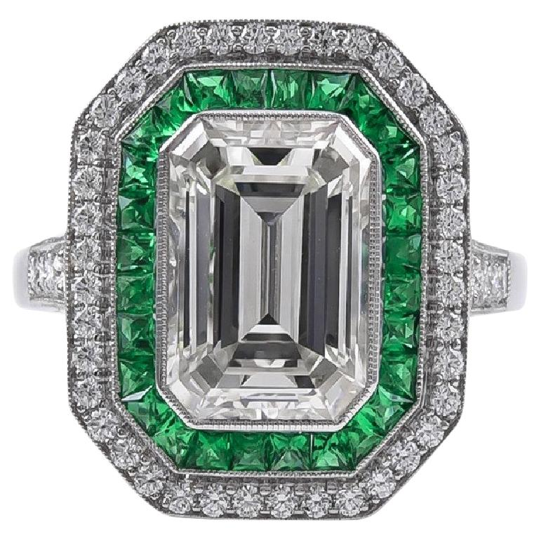Stunning 2.84 Carat Emerald Cut Diamond Ring and Emerald Ring For Sale