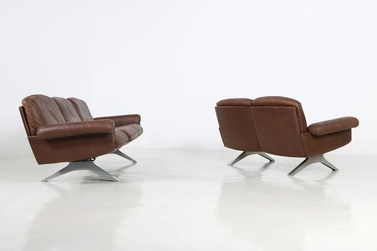A rare and beautiful set, manufactured in the early 1970s by De Sede Switzerland, Mod. DS 31 a three-seat and a matching 2 seater, a fantastic vintage condition, beautiful brown leather, authentic 1970s object in good vintage condition, with unique