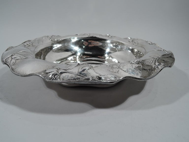Beautiful Martele silver bowl. Made by Gorham in Providence on Mar. 26, 1914. Round well with shaped base and wavy and scrolled rim. Chased and restrained floral ornament in form of strewn roses. First-rate craftsmanship and fine honeycomb hand