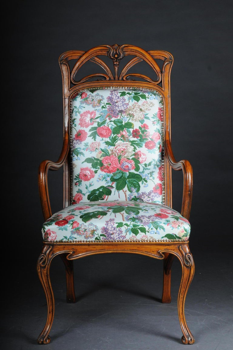 Solid wood floral carved. Rich carving. Armchair with long, curved legs. Model after Louis Majorelle. Seat and back with Classic upholstery.    (B-159).
