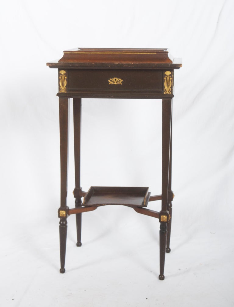 Console display hardwood table with brass ornaments and glass top made in Germany, circa 1890. Original condition.