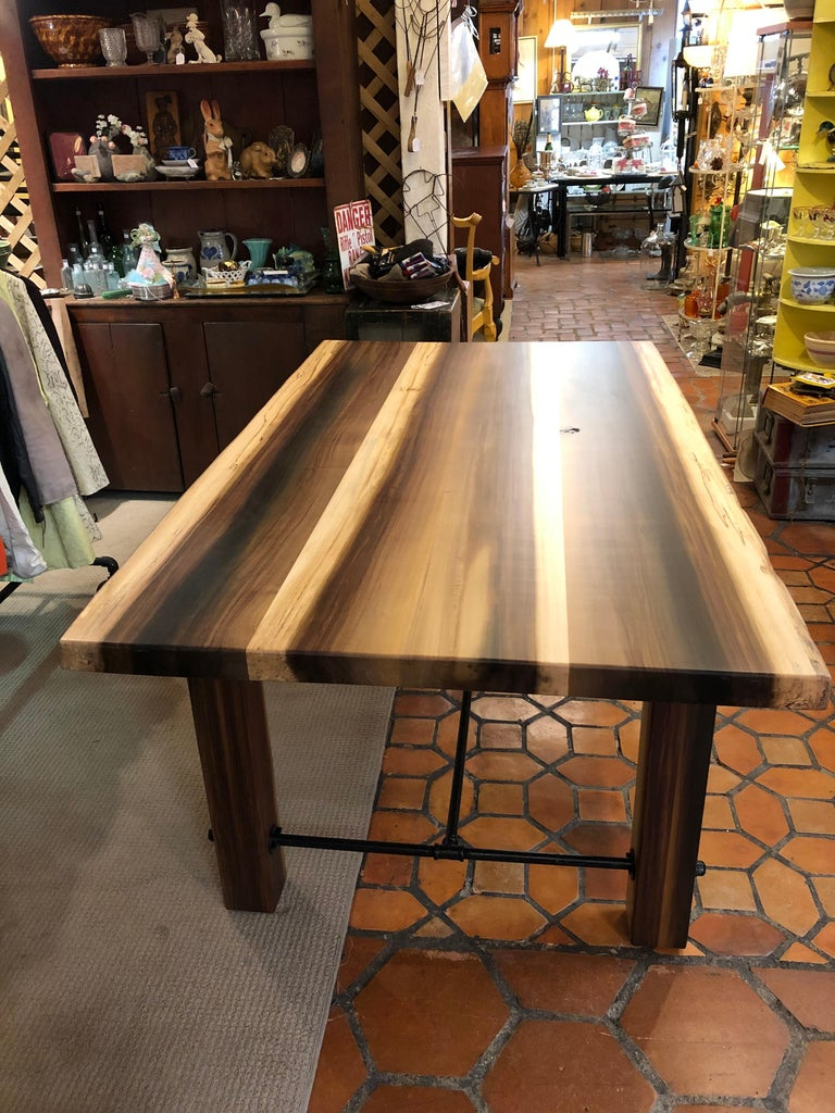 A handsome solid poplar farm table custom made by Amish artisan in Lancaster Pennsylvania having hand picked beautifully grained wood, chunky square legs and industrial black metal stretcher.  Apron height 25 Note: Depending on availability of