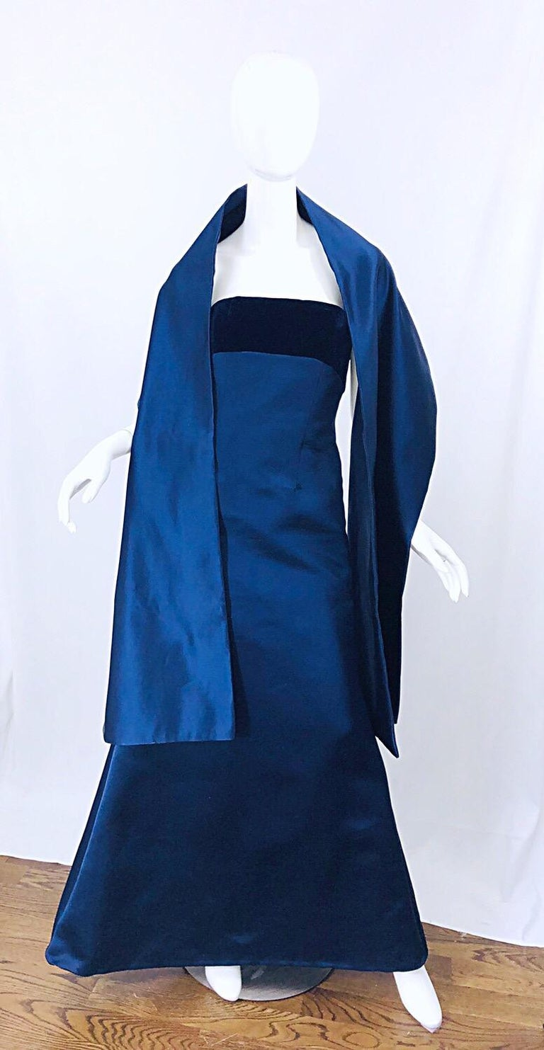 Beautiful 1990s BILL BLASS Couture navy blue silk satin strapless mermaid gown and matching shawl. Strapless bodice features a super soft silk velvet in navy. Interior support holds everything in place. Fitted bodice and body with a flared skirt