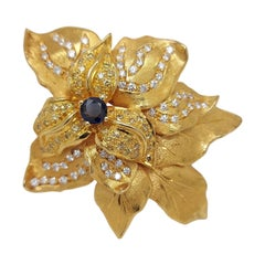 Beautiful Brooch with Fancy Yelmlow & White Diamonds & One Central Sapphire
