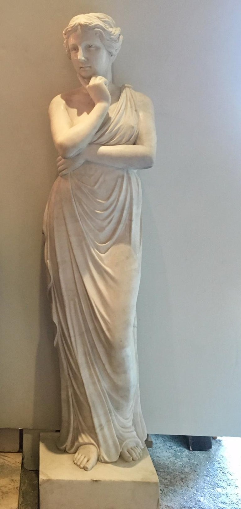 Beautiful hand-carved Venus sculpture after Greek and Roman examples. Made in Italy in the 20th century from high quality bright white Carrara marble. The sculpture is in a very good condition. 190 cm in height (including square basement), 40 cm