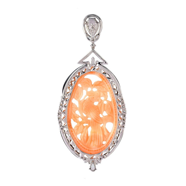 Beautiful Coral Carved Bird Pendant with Diamonds around in 18 Karat White Gold In New Condition For Sale In New York, NY