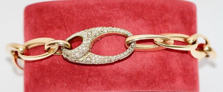 Beautiful designer bracelet made by Pomellato. 18k gold with diamonds.  Clasp fully set with diamonds.