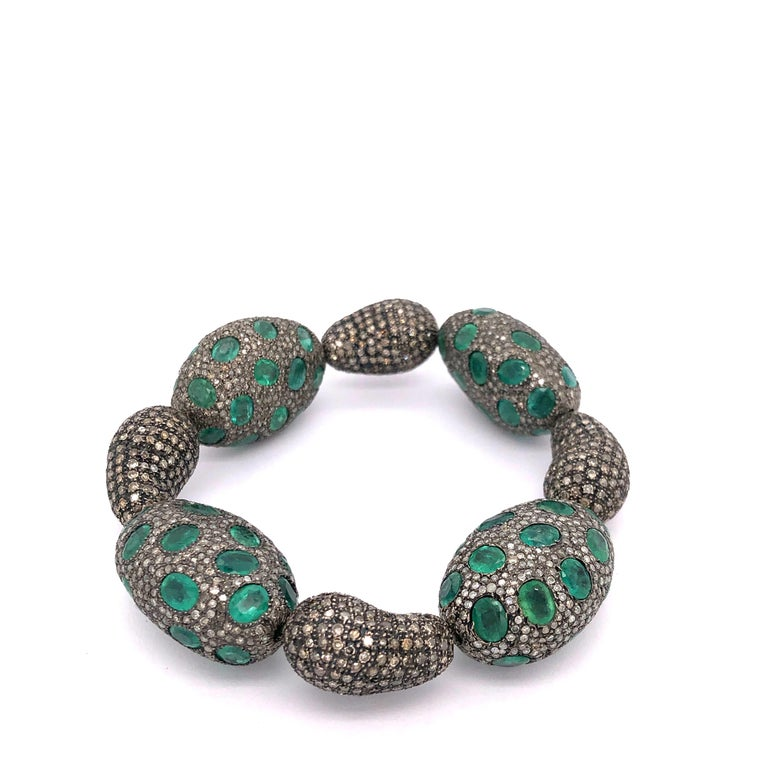 This beautiful pave diamond beads and alternating pave diamond and oval shape emerald bead will complement very well to any of your attire. All the beads are connected together with stretchable plastic cord making easy to slip on.  Silver: