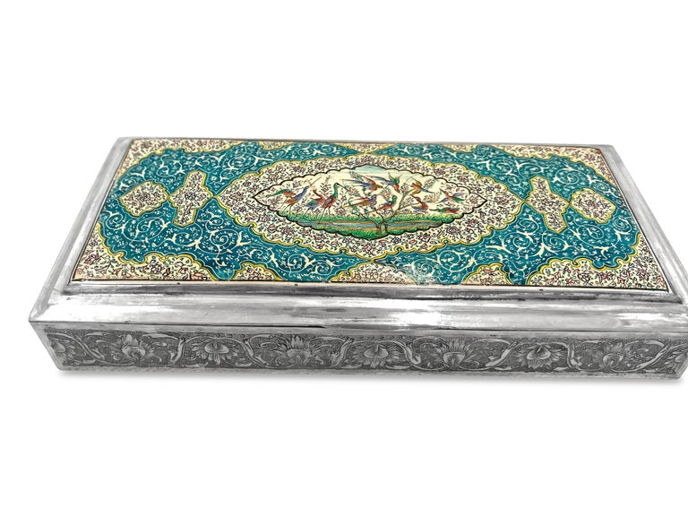 This beautiful enamel box is  absolutely gorgeous and it has been hand carved very delicately. The enamel work on top of the box is hand made too and has blue,red,yellow,green,white and black color . In the middle part has more painting of storks