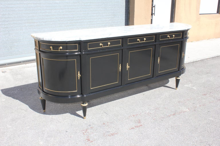 Long French antique Louis XVI style sideboard or buffet made of mahogany with a beautiful Carrara marble top, the mahogany wood has been ebonized and finished with a French polished high luster. The buffet has 5 doors and 5 drawers, and bar section,