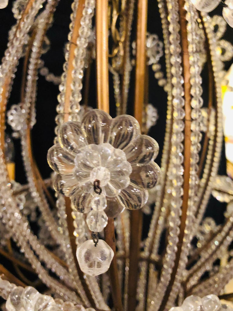 Beautiful Gilt Iron 12-Light Chandelier with Great Crystal and Bead Decoration For Sale 10