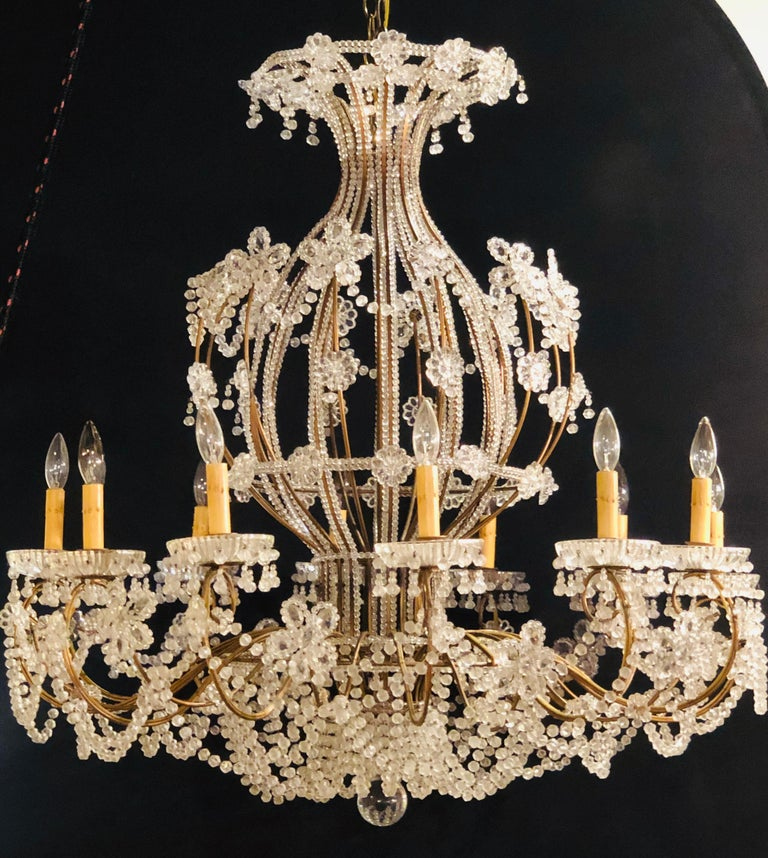 Beautiful gilt iron 12-light chandelier with great crystal and bead decoration. This massive and highly decorative chandelier is simply spectacular having a basket hot balloon form with large oversized bobeches.   GX.