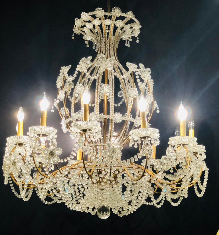 Hollywood Regency Beautiful Gilt Iron 12-Light Chandelier with Great Crystal and Bead Decoration For Sale