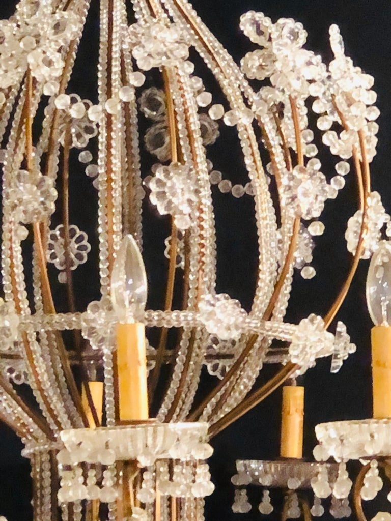 Mid-20th Century Beautiful Gilt Iron 12-Light Chandelier with Great Crystal and Bead Decoration For Sale