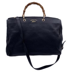 Beautiful Gucci Bamboo tote bag in black leather. Double distinctive Bamboo hand