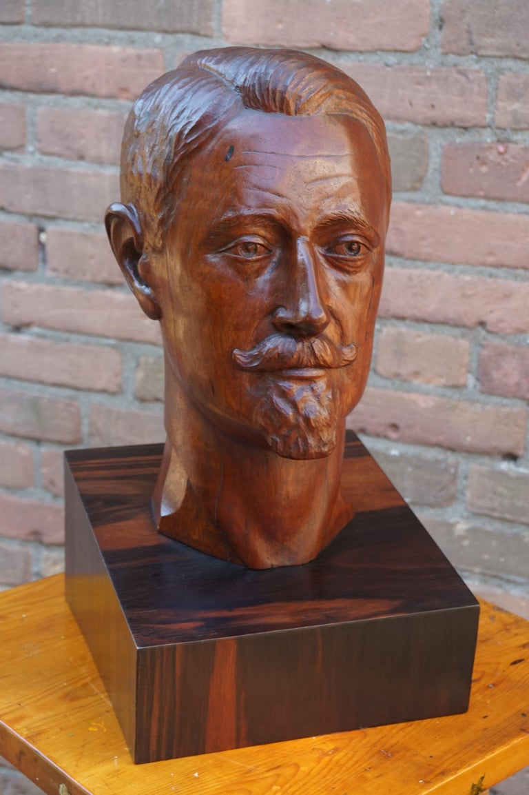 Solid teakwood bust of an attractive and clean cut gentleman on a Macassar base.  Christiaan Nicolaas Everhardus (Chris) de Moor (Rotterdam, 1899 - Amsterdam, 1981) was a Dutch artist and designer. Creating everything from wall tapestry, stained