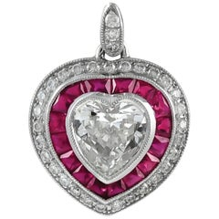 Beautiful Heart Shaped Platinum Pendant with Rubies and Diamonds