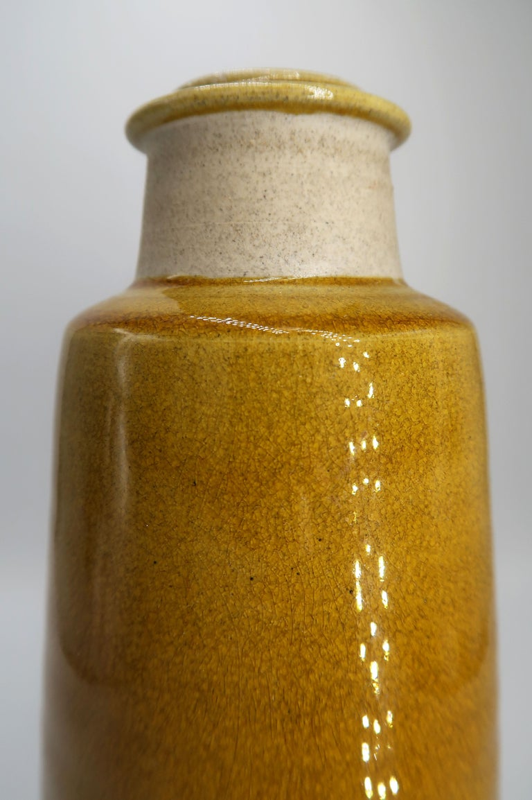 Stunning handmade Danish mid-century modern stoneware vase by Kähler. Raw neck with warm ochre shiny crackle glaze on the top and belly. Manufactured in the small Danish town of Naestved in the 1950s. Signed and stamped under base. A beautiful
