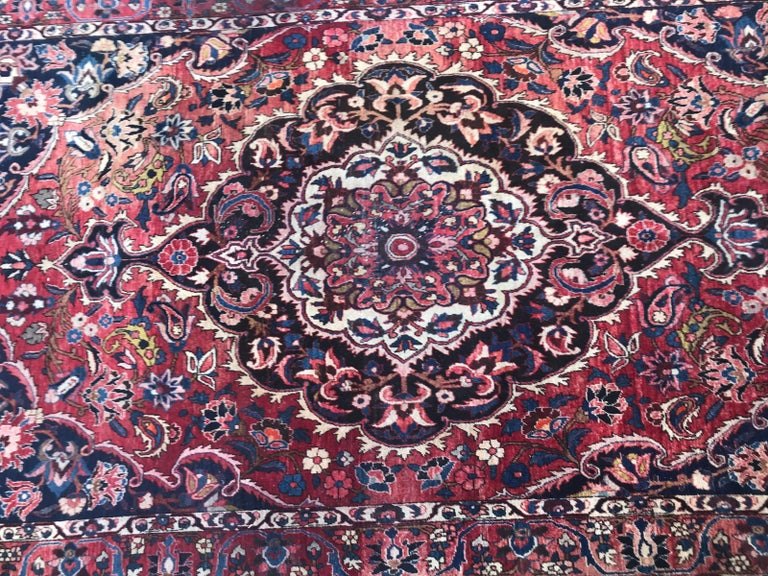 A mid-20th century large rug with a nice central medallion design and beautiful patterns and colors entirely hand knotted with wool velvet on cotton foundation.  Take a look at other Bobyrug items! , search by