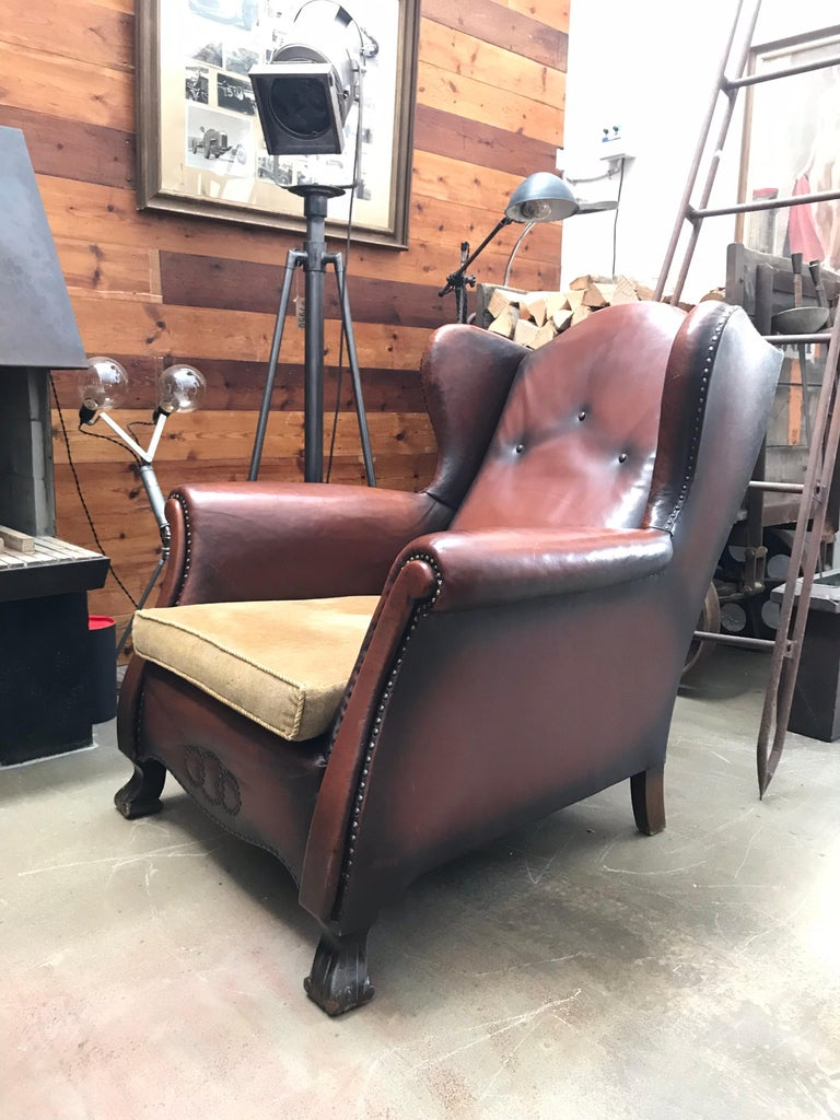 Beautiful leather and brass studded lounge club chair from the 1930s in the style of Otto Schultz