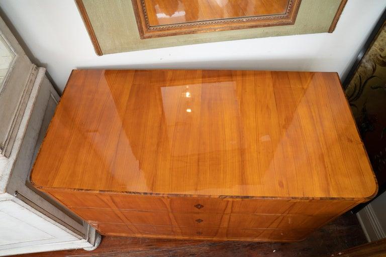 Fantastic unique 19th century Biedermeier commode. The maple has such a unique pattern which makes it a statement piece.
