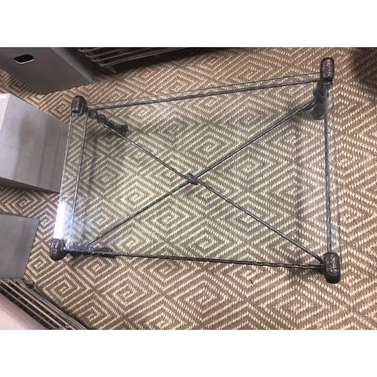 Beautiful glass top Giacometti style coffee table with criss cross hammered iron base, thick rectangular glass, and both a rustic quality and a refined sense of scale and design that makes this a very versatile piece.