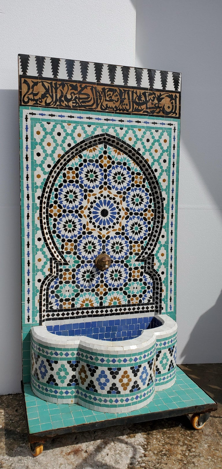 Beautiful Moroccan Moorish Fountain with carved Arabic calligraphy.