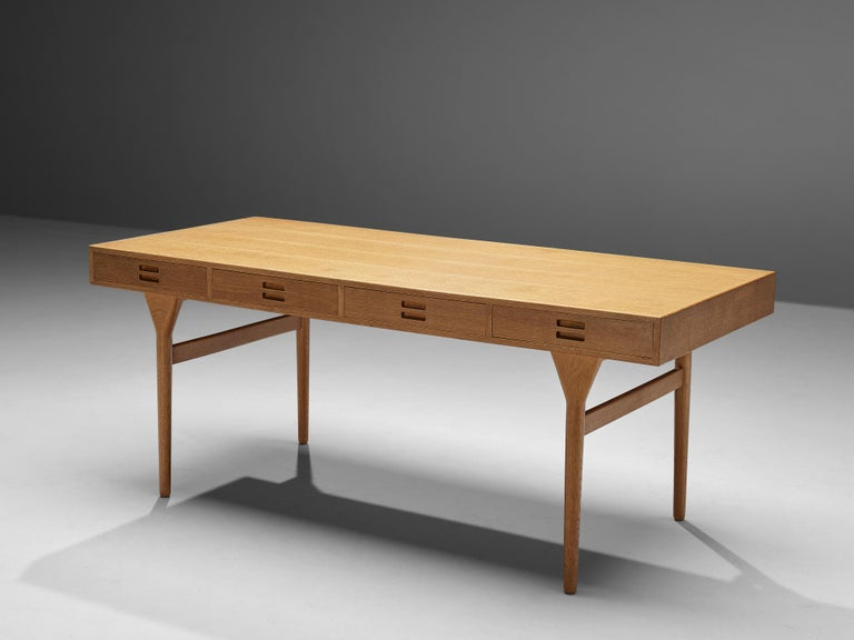 Nanna Ditzel, desk, oak, Denmark, 1950s  Danish designer Nanna Ditzel created this beautiful desk in the 1950s. Four tapered legs lift the table top with integrated drawers up. Decorative and functional detail at the same time are the handles. Two