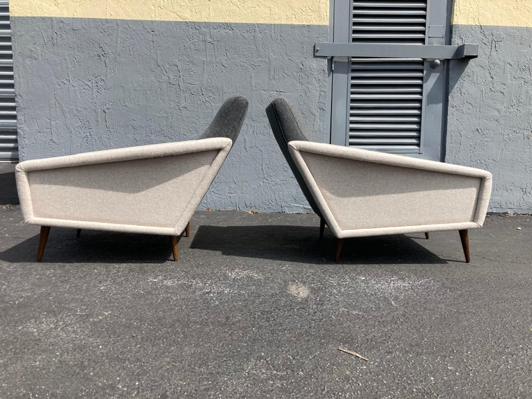 Chairs are covered in Kvadrat fabric, legs are stained oak. Beautiful large lounge chairs.