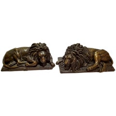 Beautiful Pair of Patinated Resting Lions, Signed by Bernoux and Huzel