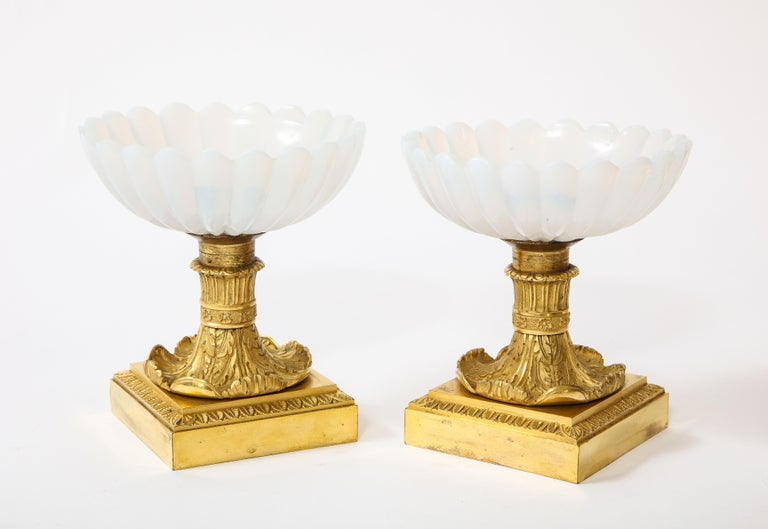A beautiful pair of Russian Empire Imperial Glass Manufactury and ormolu mounted white opalescent tazza centrepieces, each white opaline bowl beautifully hand cut and hand polished in flutted design with ribbed border; the Ormolu very finely hand