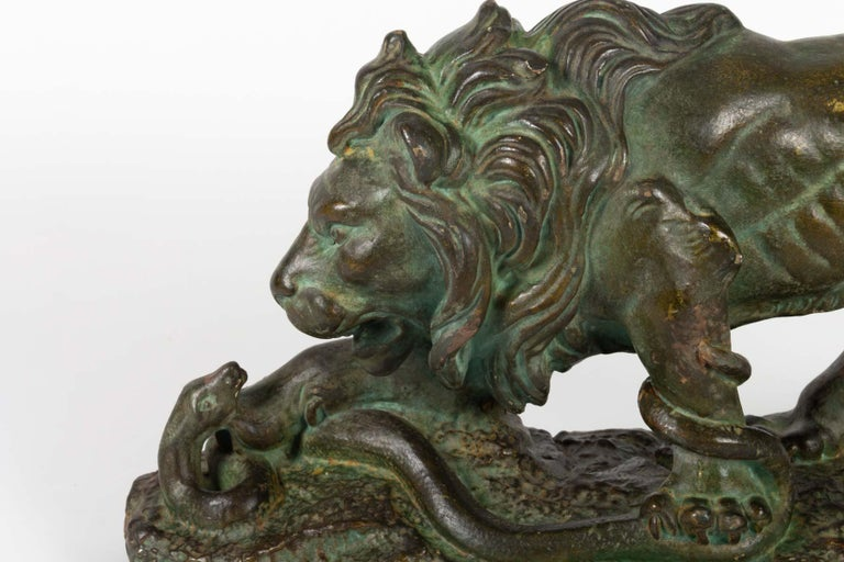 Beautiful Original Plaster Sculpture, Lion and Snake, by Romeo Capovani, Italy, ca 1925 With a bronze patina. signed Romeo Capovani is known , amongst other works, for his monument honoring the dead soldiers of WW1 in Cucigliana in Tuscany, and