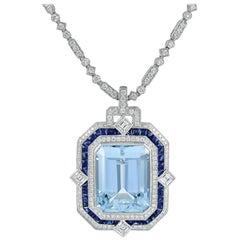 Beautiful Platinum Aquamarine Pendant Accented with Sapphires and Diamonds
