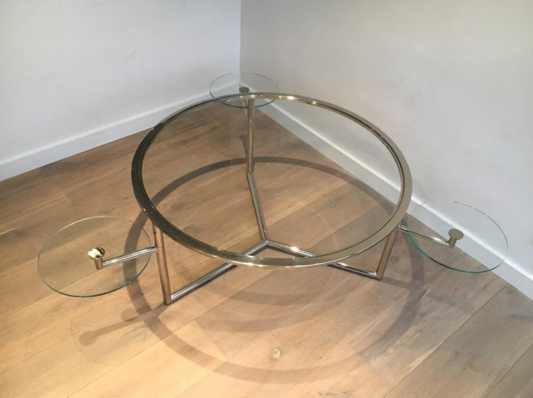 This beautiful and rare round coffee table is made of chrome with clear glass shelves. This is an interesting round model with 3 removable round glass shelves that can be adjusted to the use of the table. This is a French work, circa 1970.