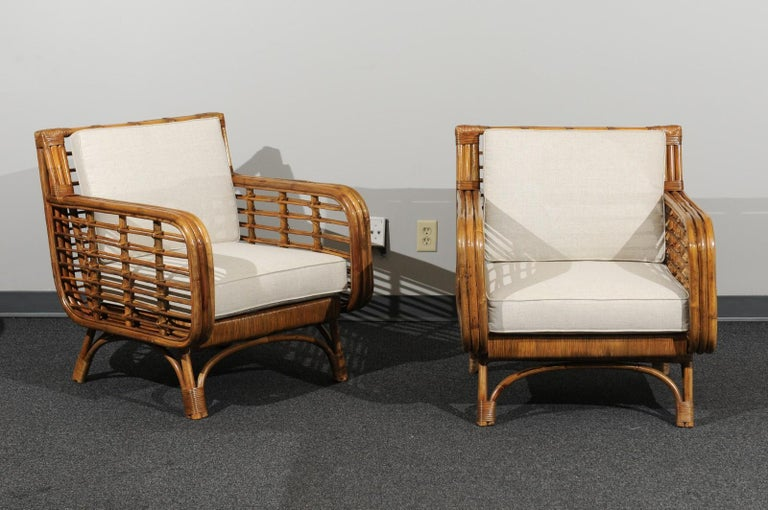 These magnificent lounge chairs are shipped as professionally photographed and described in the listing narrative: Meticulously professionally restored and installation ready. Expert custom upholstery service is available.