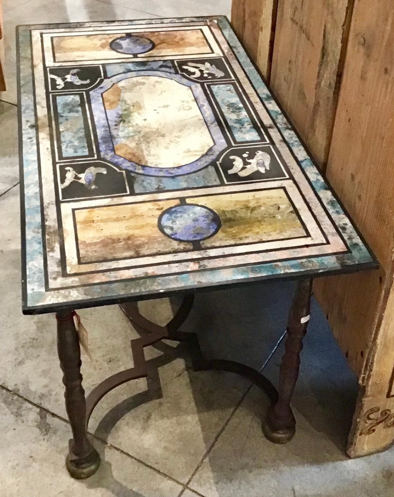 Italian Scagliola table featuring bold colors and intricate details.