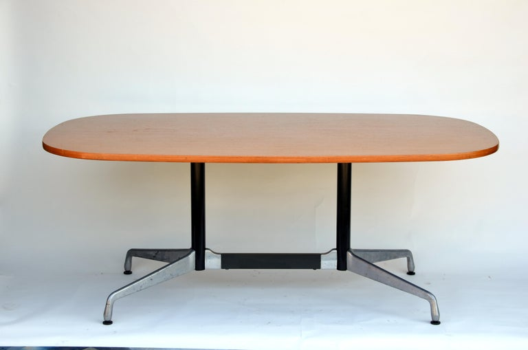 Beautiful oval table by Eames for Herman Miller. Segmented aluminum base with a rare bamboo top.