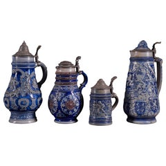 Beautiful Set of 4 Vintage Ceramic Beer Carafes with Indigo Blue Decorations