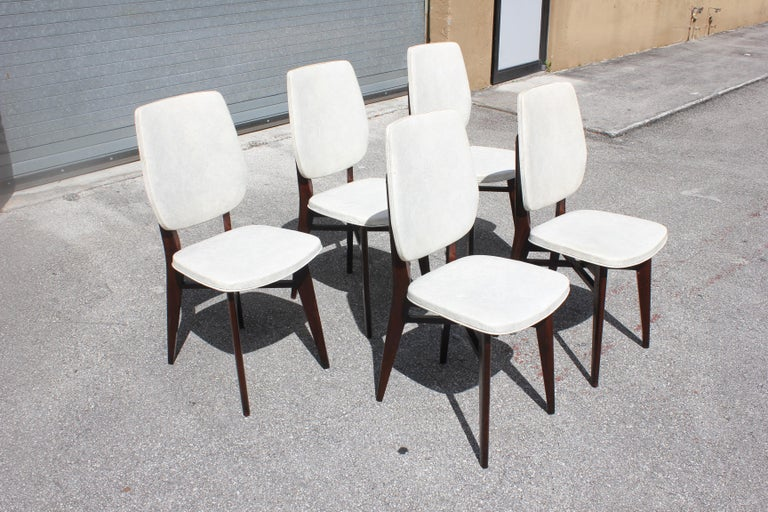 A set of 5 French Art Deco solid mahogany dining chairs. The chair frames are in excellent condition. But the (Reupholstery is vinyl recommended for all 5 dining chairs).