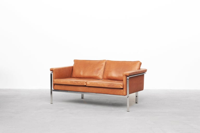 Very beautiful two-seat sofa designed by Horst Brüning and produced by Alfred Kill International in Germany, circa 1968. This sofa is in excellent condition, without any signs of usage. The cushions and the entire body were newly reupholstered with